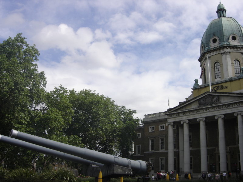 Barrels of 2 naval guns stranded on land in front of the former-hospital that is now the Imperial War Museum in London.