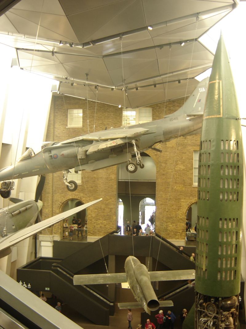 A WW2 bomb next to a Harrier plane active from 1990 to 2010.